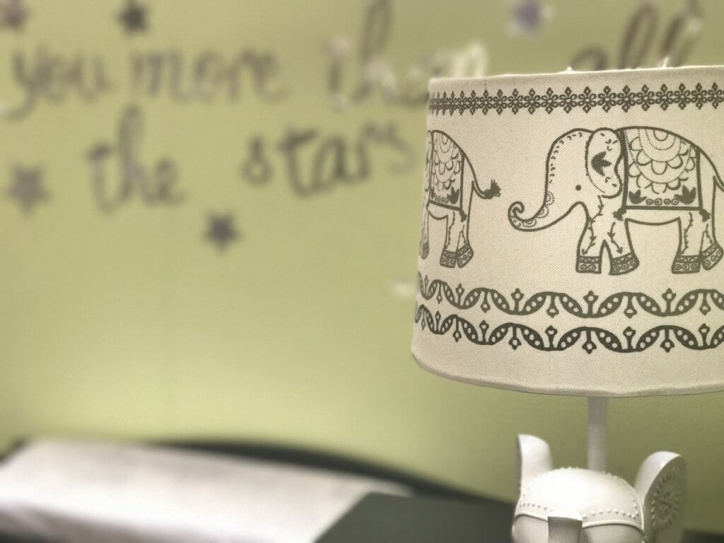 lamp with an elephant print in child's room