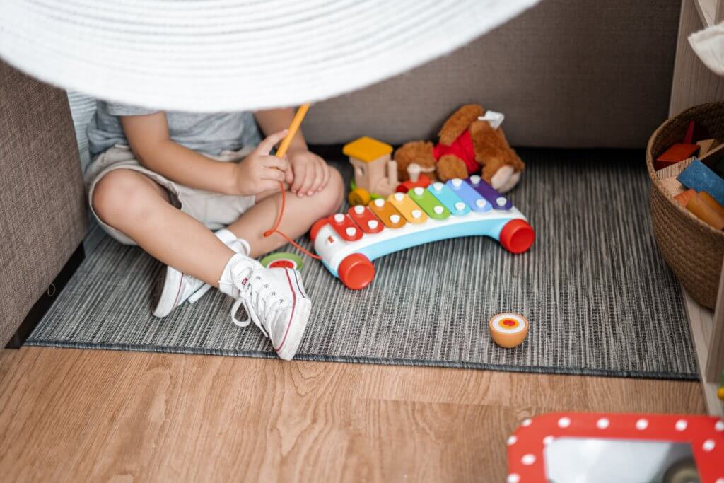 young child on floor playing with toys