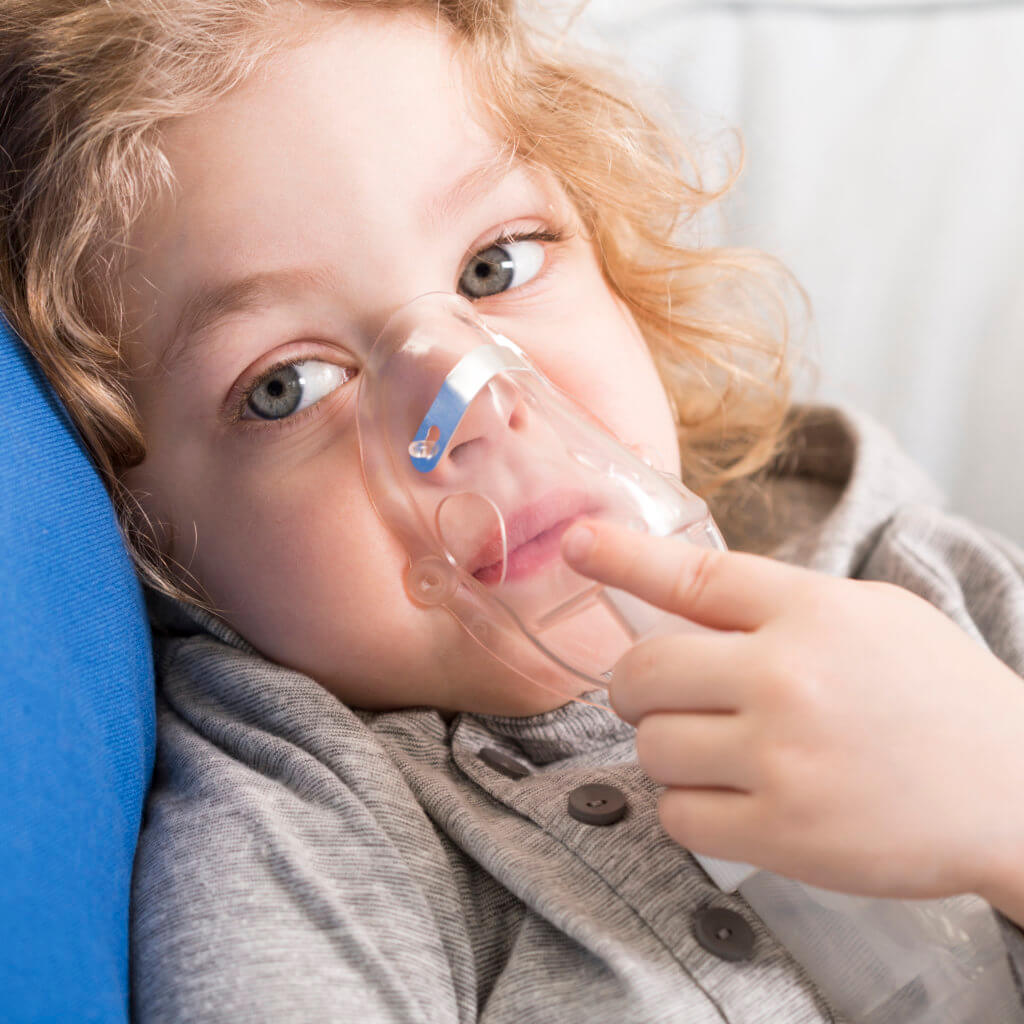 small child with nebulizer
