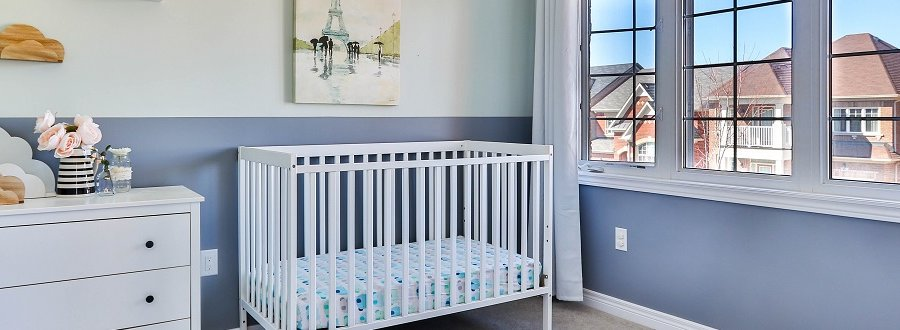 a baby's nursery with a window