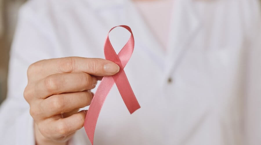 doctor holding pink ribbon