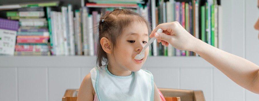 a young child being fed