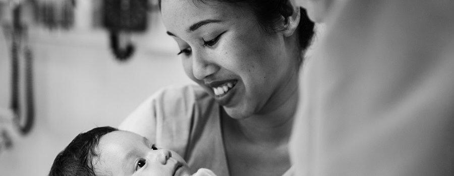A newborn baby with mom