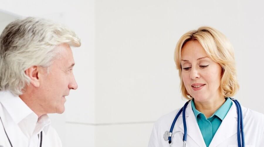 Senior patient talking to his doctor
