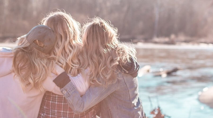 a group of women hugging outdoors